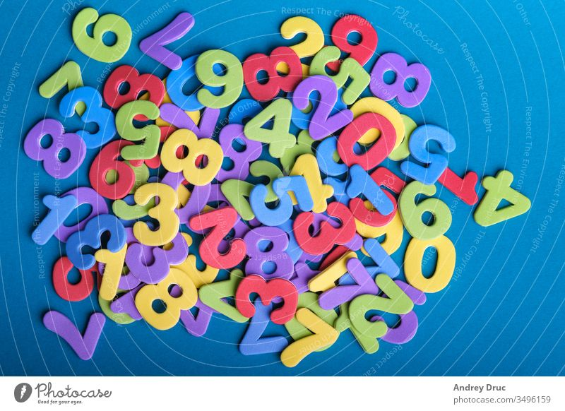 educational toy. wooden toy. numeral. training account. child development. geometric figures. colorful numbers abc algebra alphabet arithmetic background blue
