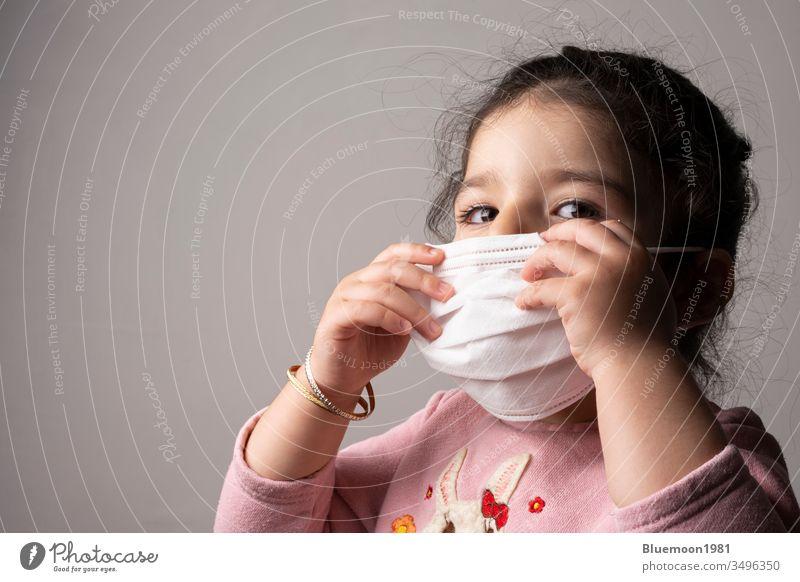 Little girl portrait wearing mask for protection from epidemic coronavirus hospital child concept medical pandemic children safe alert care pollution big