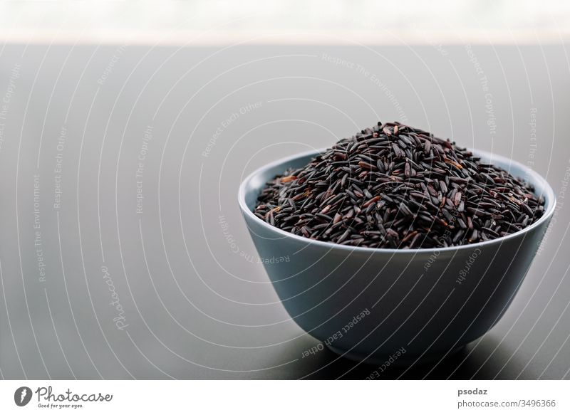 bowl of jasmine black rice on black backgrounds agricultural agriculture agriculturist asia asian berry breakfast cereal cloud cooked cooking cultivation dry