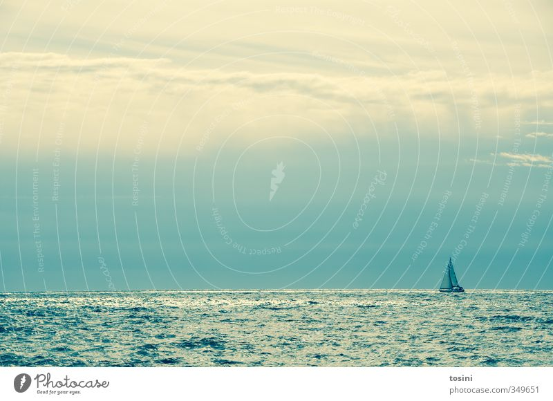be small Nature Water Weather Beautiful weather Ocean Navigation Sailboat Sailing ship Blue Watercraft Heaven Clouds elemental Waves Loneliness Challenging Calm