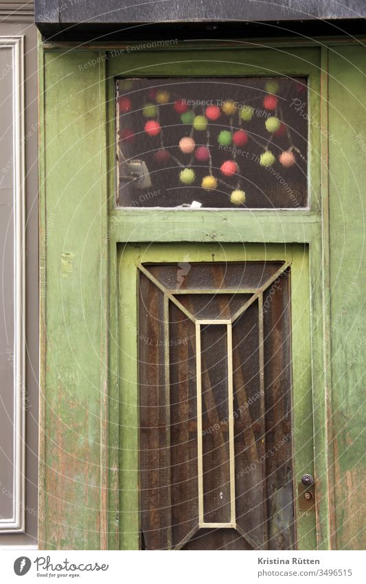 Green Front Door And Colourful Light Chain A Royalty Free Stock Photo From Photocase