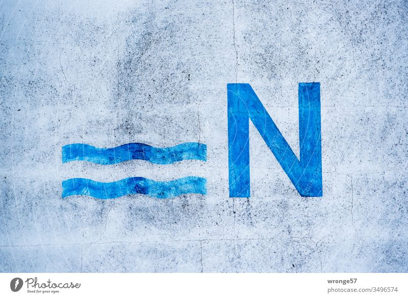 Large blue N and 2 wavy lines on a house wall Blue Capital letter Exterior shot Letters (alphabet) Facade Characters Deserted Colour photo Copy Space top