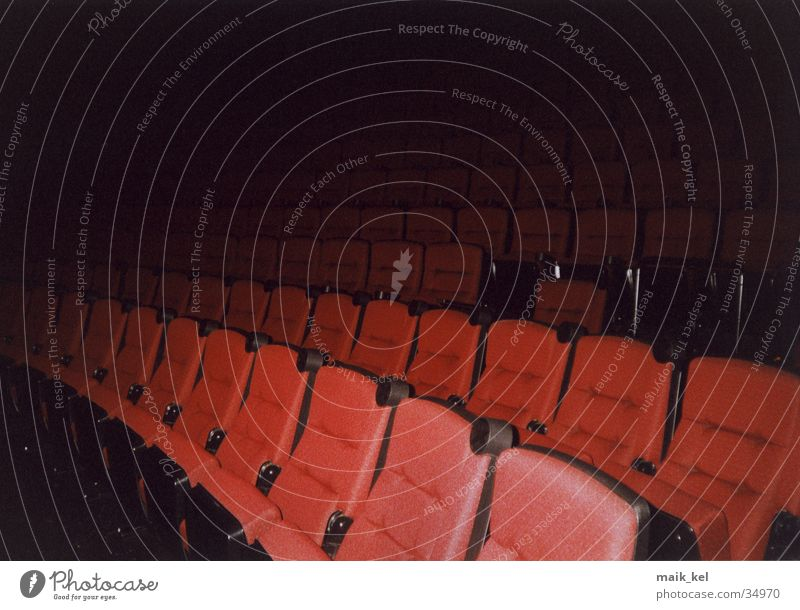 At the cinema Cinema Dark Row of seats Movie hall Lecture hall Leisure and hobbies Seating