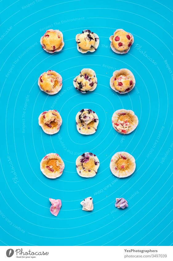 Eating muffins in steps. Fruit muffins top view above view ate bite blueberry muffin breakfast cakes calories collage comfort food composition convenience food