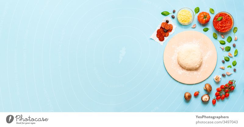 Preparing pizza concept. Ingredients and dough for pizza above view banner basil blue background cheese colorful convenience food cooking copy space cuisine