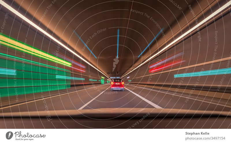 Fast driving car through a tunnel with blurry light effects, a urban race scene with leading lines and symmetry structure. speed fast background pattern