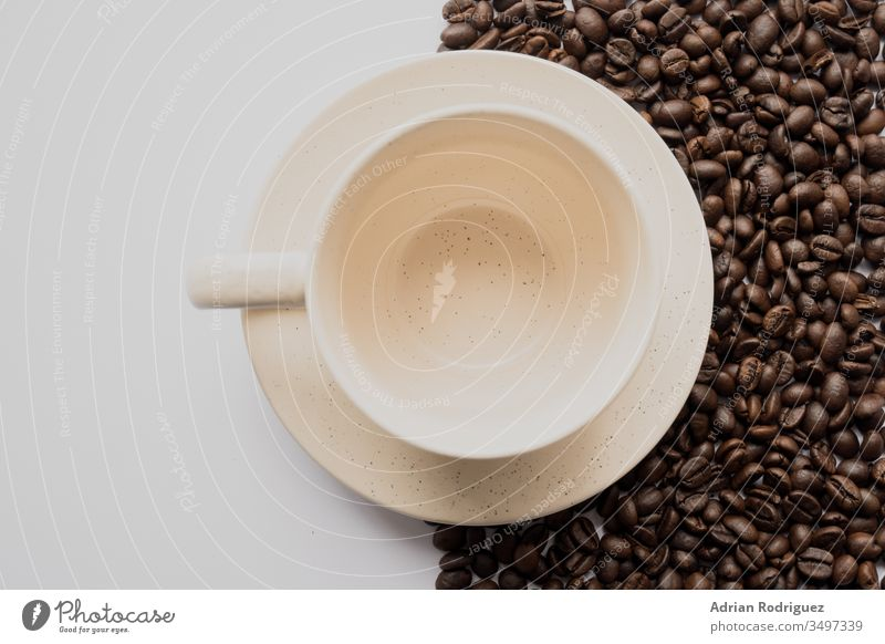 Emty white coffee cup with coffee beans and a white background dark food seed brown caffeine drink roasted beverage espresso ingredient black cafe natural
