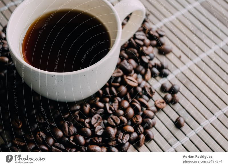 Closeup shot of a cup of coffee with coffee beans drink cafe young lifestyle beverage woman table aroma warm white adult casual tea mug morning relaxation