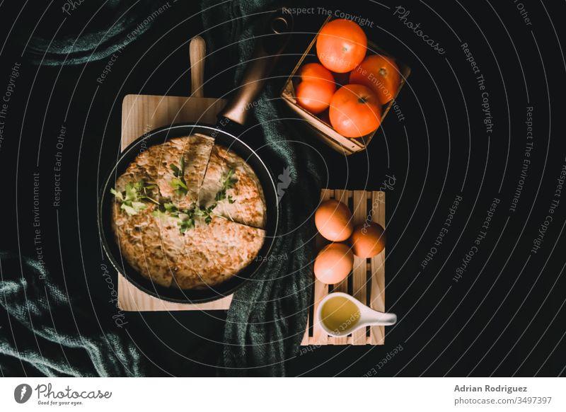 Closeup shot of an omelet in a roaster, fresh eggs, and tomatoes closeup breakfast breakfast menu food blog menu usage healthy breakfast Easter breakfast meal