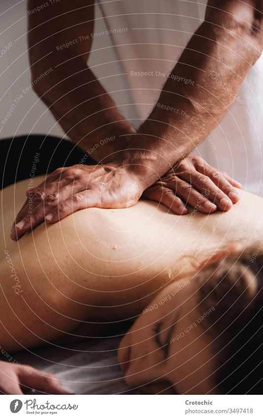 Reiki session alternative therapies. Hands transmitting energy on the back aromatherapy arthritis being bodycare bone chiropractor clinic cosmetic dayspa doctor