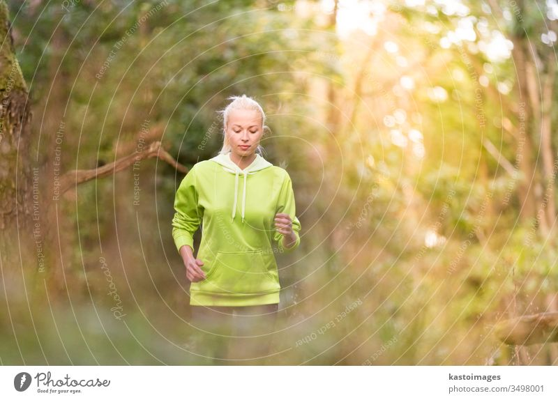 Pretty young girl runner in the forest. active sport female exercise fit woman person lifestyle recreation adult outside jogger leisure fitness athletic energy
