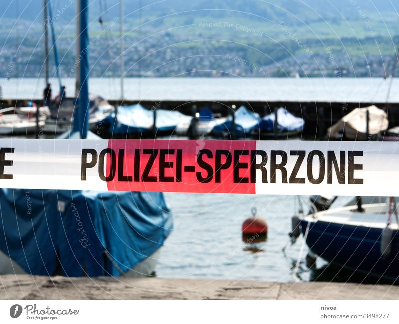 Corona Polizei Absperrung police Sign Exterior shot Safety coronavirus Surveillance Police Force Protection Lakeside Lake zurich Day Observe Colour photo