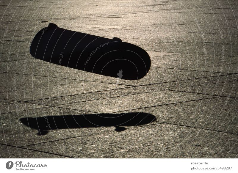 he jumped   close to it   and his skateboard flew on without him Skateboard Shadow Jump Skateboard Jump close missed Sunlight evening light Light Silhouette
