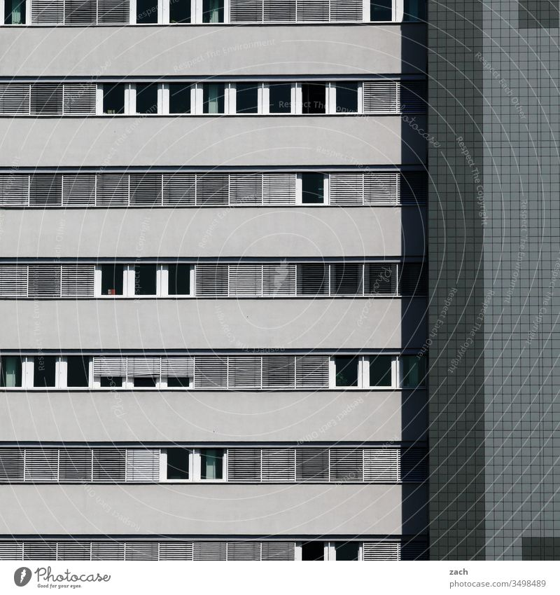 Facade of a high-rise building in grey Town Wall (barrier) Wall (building) door Architecture built Line House (Residential Structure) High-rise High-rise facade