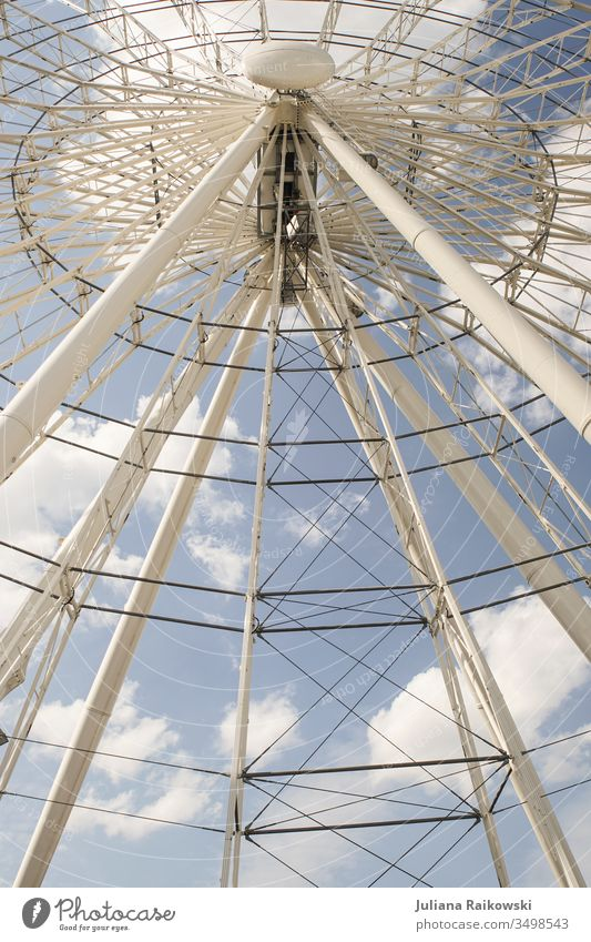 Ferris wheel in Munich Fairs & Carnivals Light Leisure and hobbies Sky Tall Feasts & Celebrations Round Exterior shot Colour photo Day Theme-park rides Blue