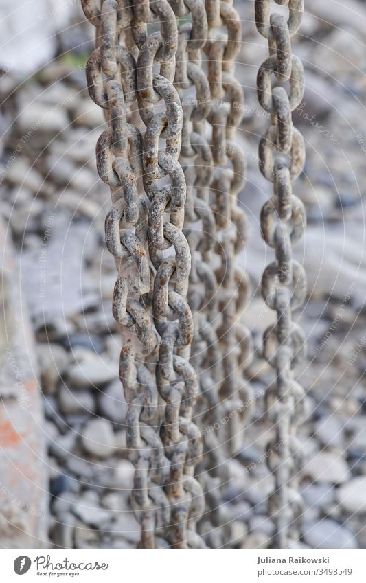 Rusty chains on a construction site Chain link Metal Colour photo Exterior shot Deserted Old Steel Safety Shallow depth of field Strong Attachment Detail