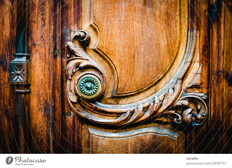 Decorated wooden door with a knob Wooden door Ornate decoration Wood work Arts and crafts Craftsman shape Structures and shapes Spirited Harmonious Front door