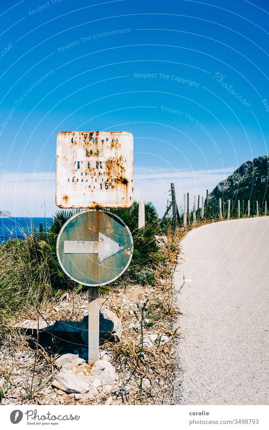Old road sign on a coastal road Coastal road Mediterranean sea Ocean Curve Right Arrow Along here Exterior shot Colour photo Deserted Transport