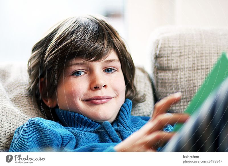 because reading simply makes you happy! Face portrait Interest Interior shot Parenting Literature Colour photo Reading Boy (child) Infancy Child Book Study
