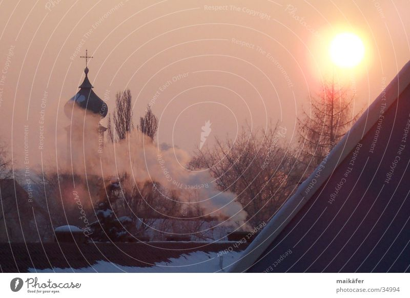 break of dawn Sunrise Morning fog Back-light Mystic Dusk Sunset Red Winter Church spire Religion and faith Fog church roof chimney smoke Dawn