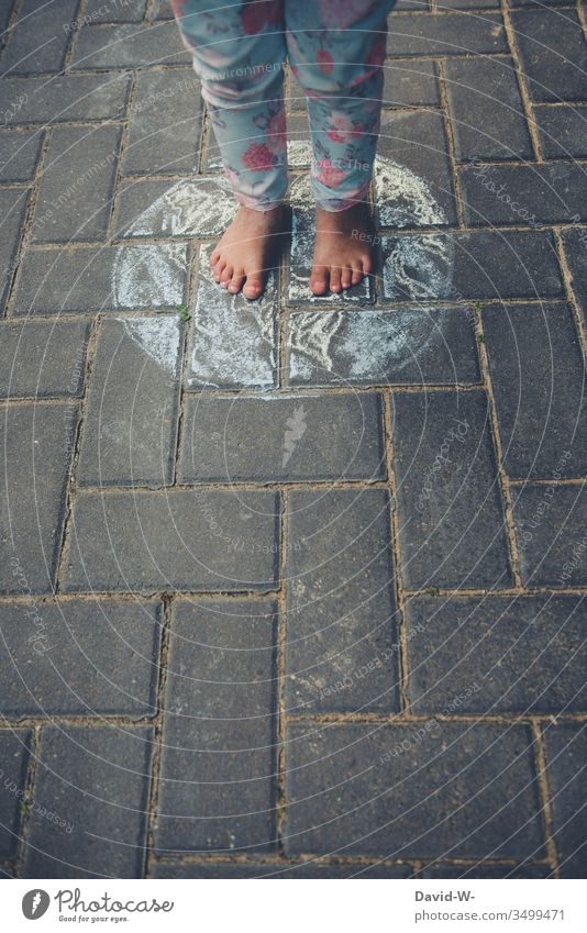 children of the earth Child stands Stand out Ground Chalk Drawing Future world Globe Global Around-the-world trip Innocent Fear of the future Small foot