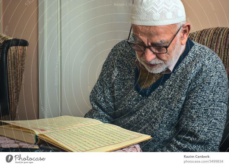 Ankara/Turkey - 24.04.2020: Very old Turkish muslim man reciting Qur'an in Ramadan elderly very old 80s male person bearded islam moslem reading recitation