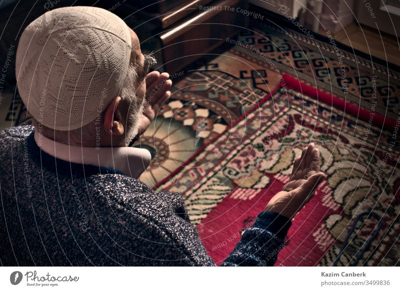 Very old Turkish Muslim man at his 80's praying to Allah at home on his rug elderly male person prayer prayer cap islam muslim moslem bearded carpet turkey
