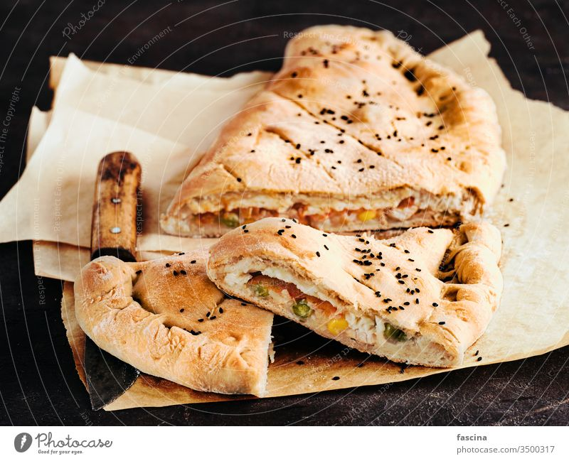 Closed pizza calzone, copy space calzone pizza homemade closed pizza italian food cheese dinner crust lunch baked fresh traditional dough meal cuisine delicious