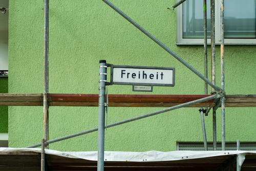 Freedom requires extensive renovation Street sign Facade Road marking Orientation spandau Traffic infrastructure metal rods Scaffolding Redecorate Redevelop