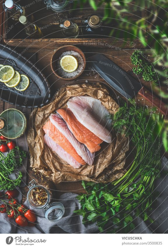 Various colorful fish fillets on eco friendly paper . Rustic kitchen . Ingredients for tasty home cooking. Top view. Still life. group various rustic table