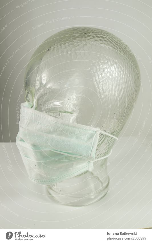 Glass head with breathing mask Respirator mask Virus Mask Illness coronavirus Healthy flu Protection Epidemic Risk of infection Infection Corona virus pandemic