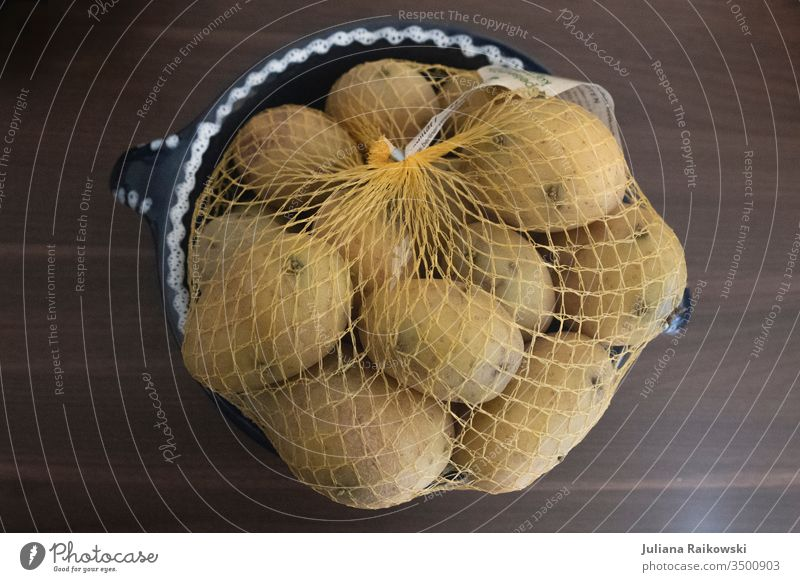 A bag of potatoes in a plastic net Potatoes Sack Nutrition Food Vegetable Colour photo Vegetarian diet Organic produce Diet Interior shot Healthy Eating Fresh