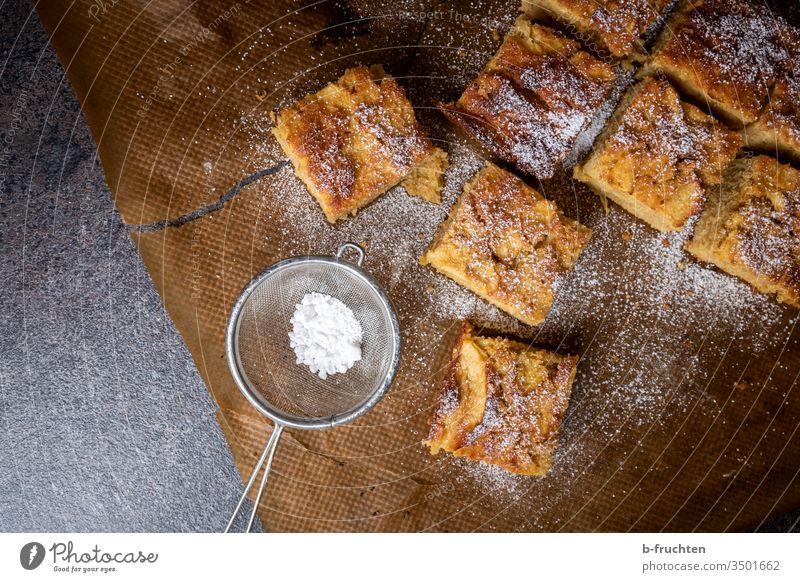 Apple pie on baking paper Cake pieces Sieve Confectioner`s sugar Sugar Sweet Food Delicious Nutrition Dessert Fruit Vegetarian diet Baking Baked goods