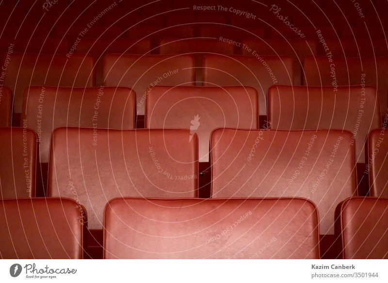 Empty red seats of a theater after the curfew regarding corona virus art opera theatre cinema closed empty quarantine global pandemic covid 19 social life