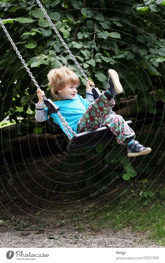 Child has fun on the swing | Favourite person youthful Human being Toddler Swing Joy To swing game Movement Playground Laughter Playing Infancy Colour photo