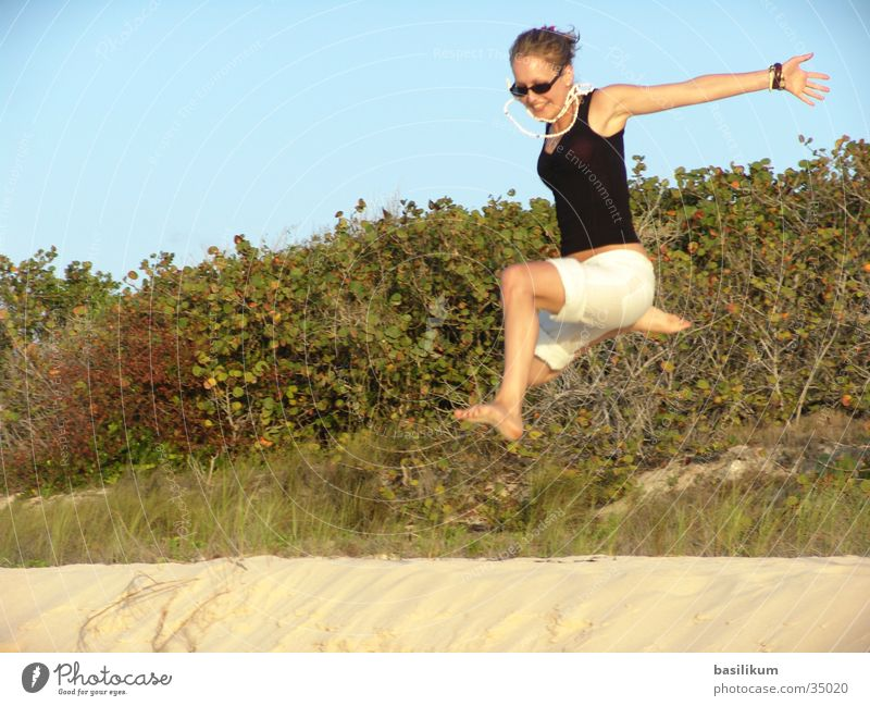Woman Vacation & Travel Beach Sand Jump Island Bushes Palm tree Cuba Hop