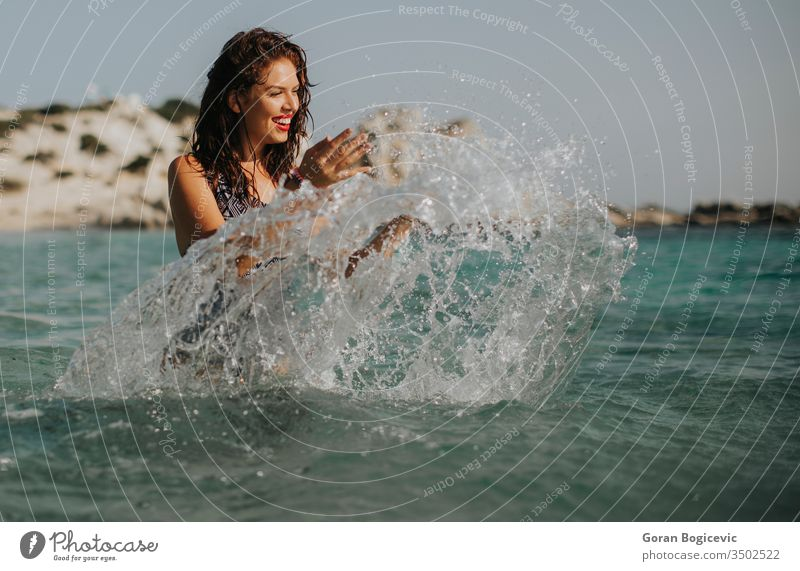 Young woman walking in the warm sea water at summer beautiful beach beauty holiday vacation travel young tourism nature relax female coast horizon blue enjoy