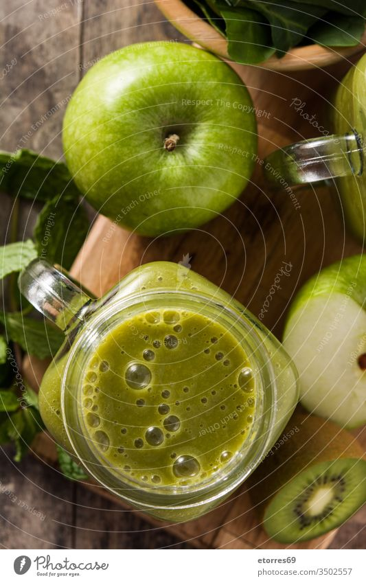 Healthy green smoothie in jar on wooden table apple detox diet drink food fresh fruit ginger glass healthy healthy drink kiwi mint nutrition shake spinach