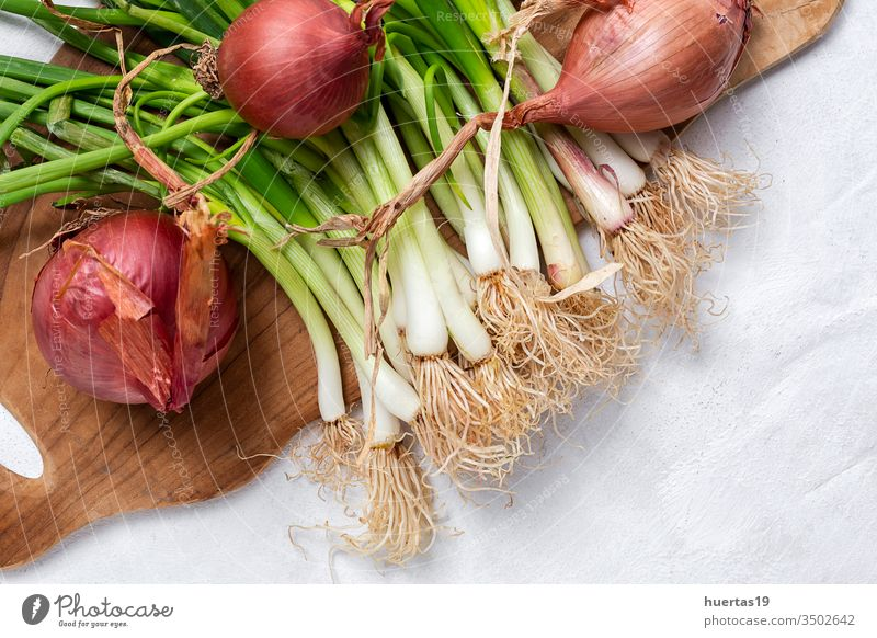 Fresh red and white onions on white background food vegetable ingredient natural healthy food fresh vegetarian vegan organic group raw plant nutrition bulb