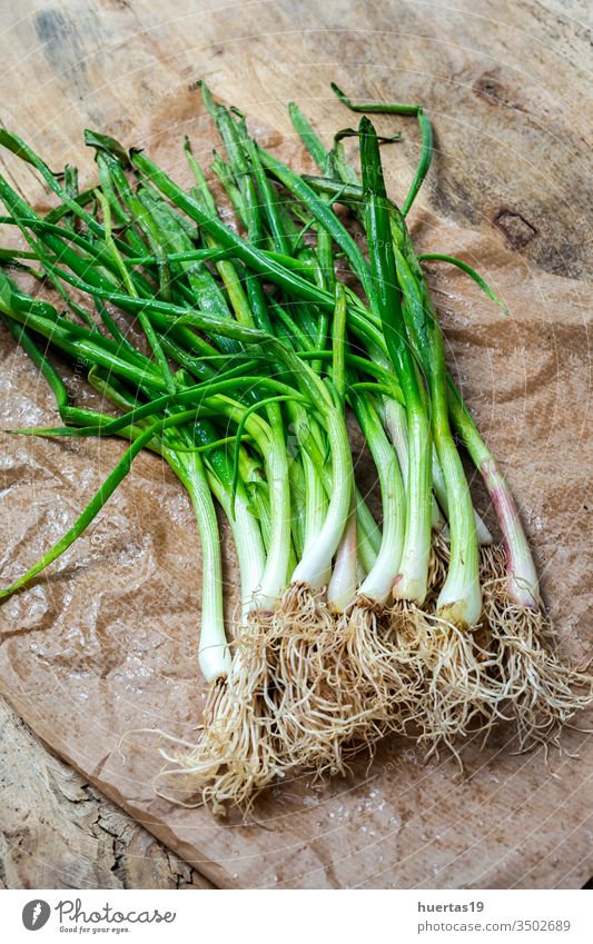 Fresh red and white onions on wood background food vegetable ingredient natural healthy food fresh vegetarian vegan organic group raw plant nutrition bulb green