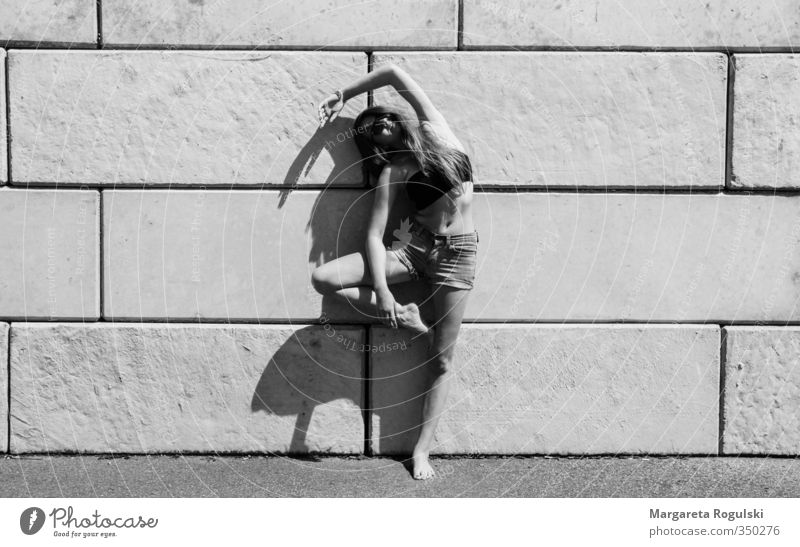 stand Black & white photo Wall (barrier) Woman Bend Stand Dance Yoga Stone Concrete Shadow Sun Middle Fashion