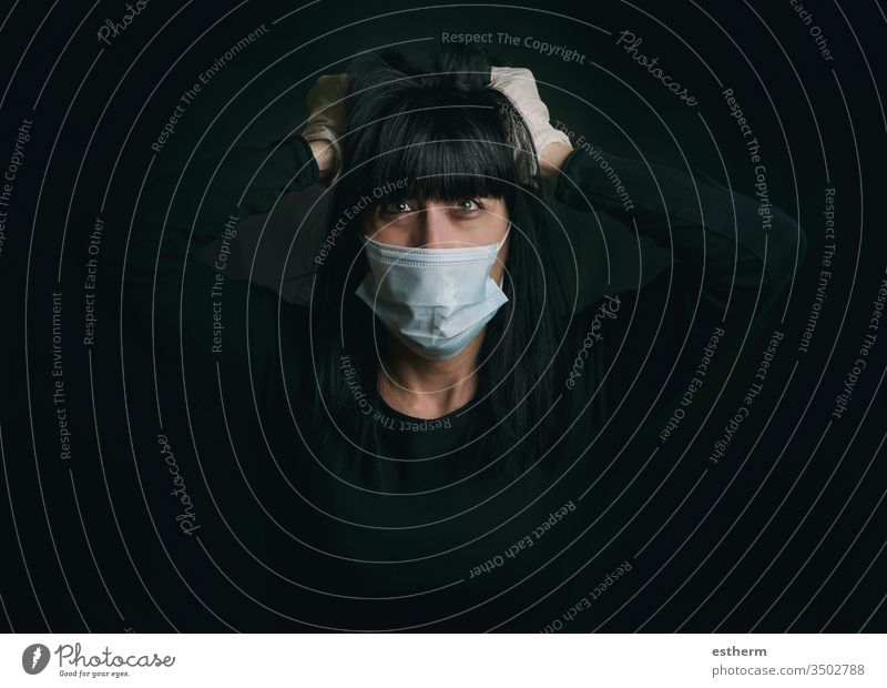 Coronavirus,young woman wearing medical mask desperate for the quarantine coronavirus covid-19 epidemic pandemic stay home furious stressed nervous despair