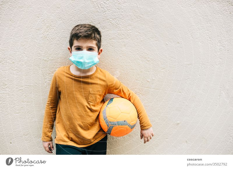 Little boy with a ball and protective mask. 2019-ncov allergy alone child childhood corona corona virus coronavirus covid-19 covid19 cute epidemic face