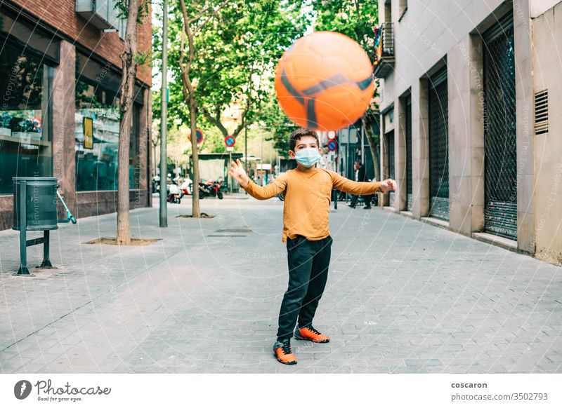 Little kid throwing a ball with a protective mask 2019-ncov allergy alone boy child childhood corona corona virus coronavirus covid-19 covid19 cute epidemic