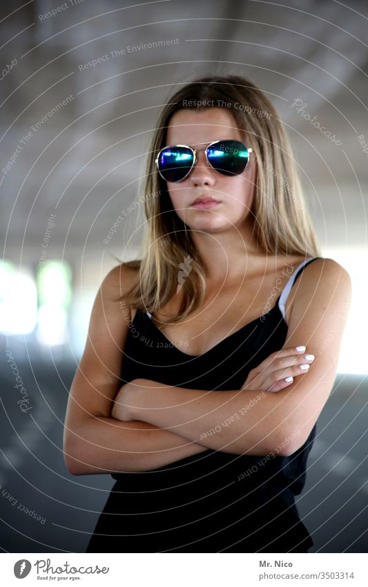 Portrait with sunglasses Self-confident Cool (slang) Sunglasses Lifestyle portrait Looking Hair and hairstyles Accessory Fashion already Long-haired Black