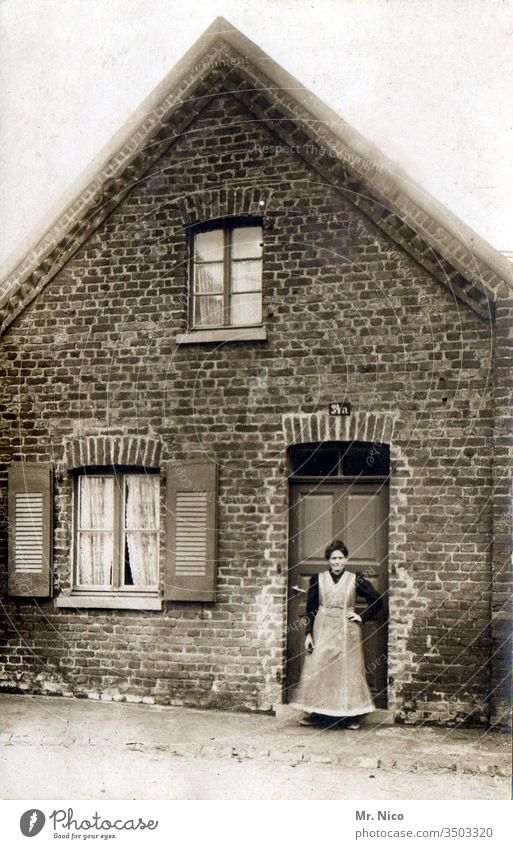 Grandma her little house Post-war period Past Nostalgia Memory Analog Front door House (Residential Structure) Grandmother Life Old Smock Apron Stand
