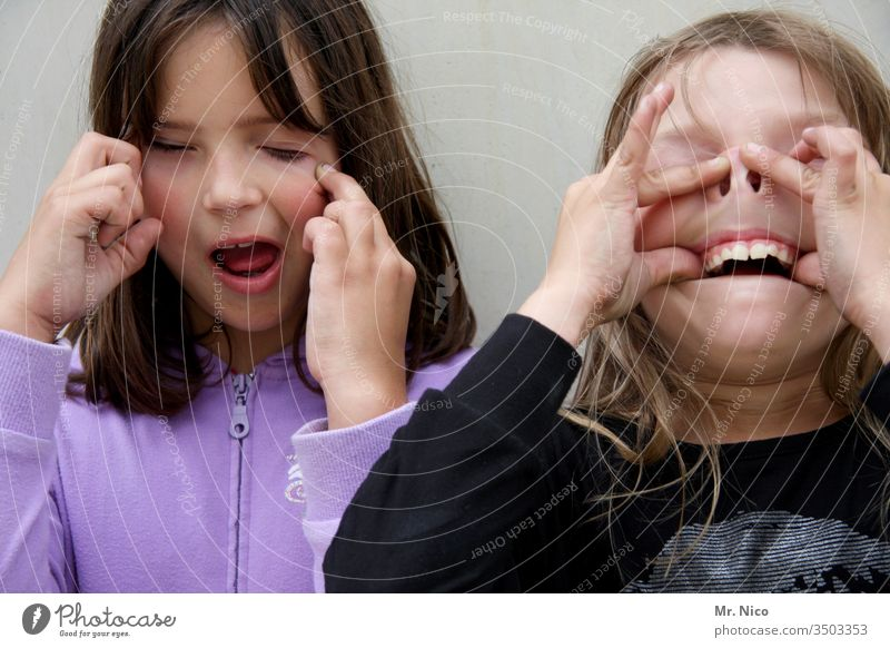 make faces Grimace grimace Brash Funny Happiness Snapshot Fingers Infancy fun Face portrait Facial expression Crazy girl Easygoing Teeth girlfriends Joy