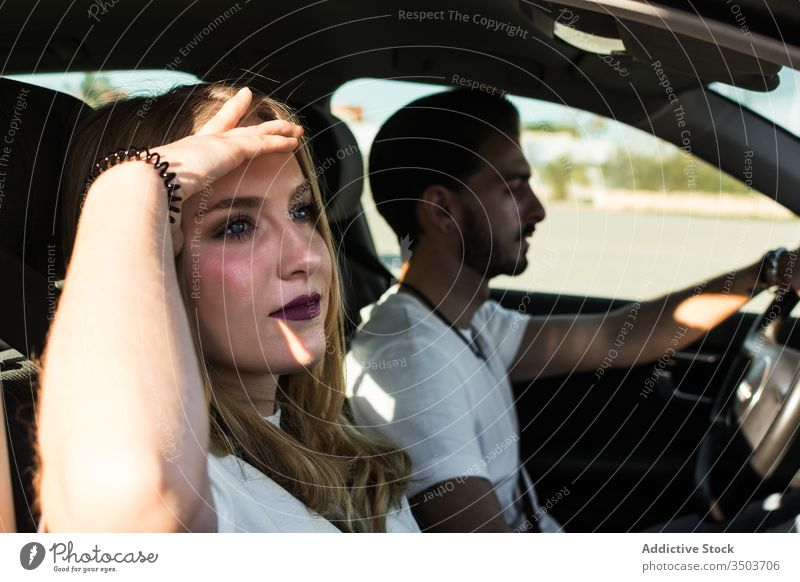 Young couple enjoying road trip car together young summer travel relax journey vacation boyfriend girlfriend relationship carefree casual holiday ride drive