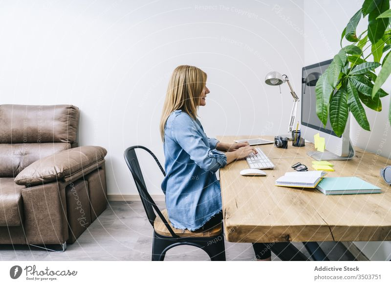 Blonde woman working at home desk young computer communication businesswoman indoor smart table female laptop desktop design lifestyle office freelance