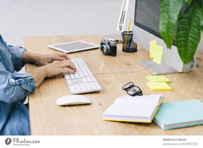 Anonymous woman working at home desk young computer communication businesswoman indoor smart table female laptop desktop design lifestyle office freelance